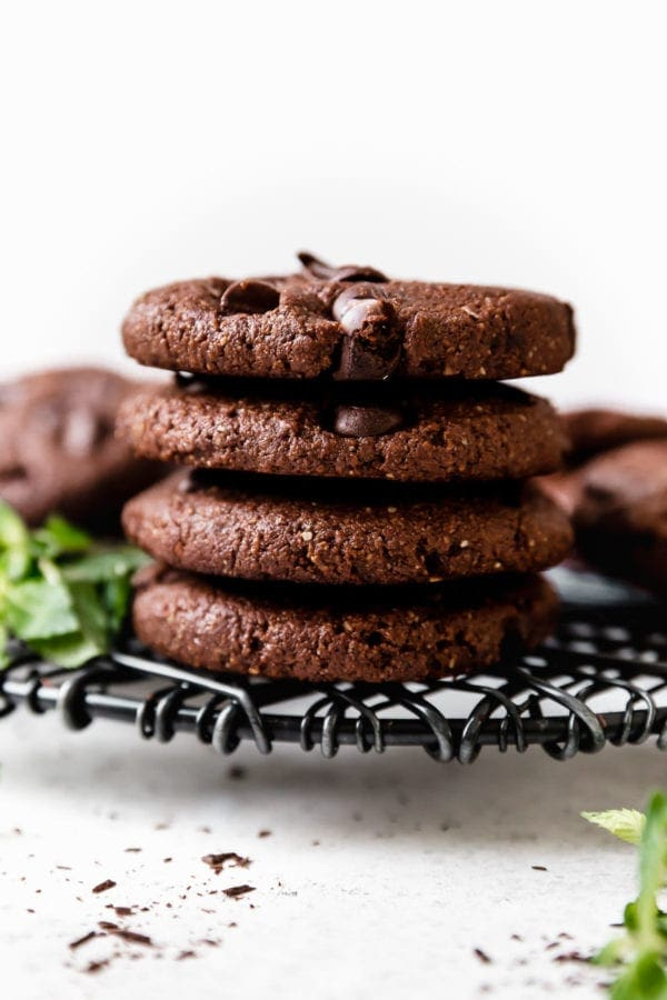 A stack of four Low Sugar Double Chocolate Mint Cookies on a wire cooling rack ready to be enjoyed!