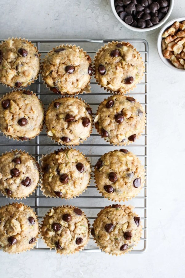 Photo of Gluten-free Chocolate Chip Zucchini Muffins on a cooling rack.