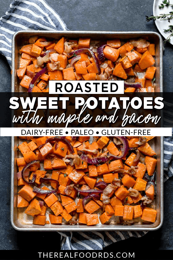 Overhead view of roasted sweet potatoes, red onion, and bacon on a baking sheet.