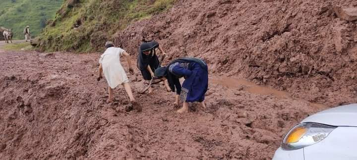 Opinion | Road, landslide, slush and the local ladies trying to put it back in shape!