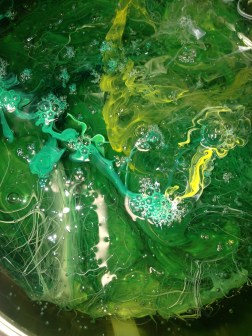 Green and Yellow pigment swirling around in a transparent base Copyright 2016 Madison Cole Howard