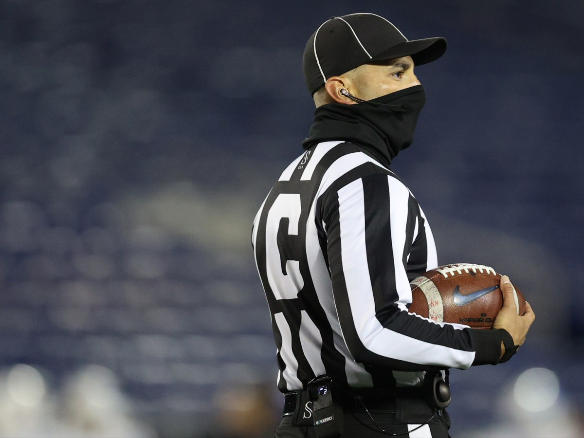 A college football referee wears a face covering due to Covid-19 pandemic