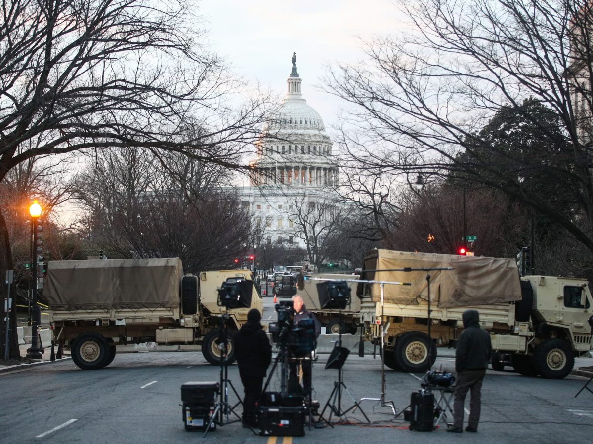 Journalists are seen in a blocked street near the US Capitol Building
