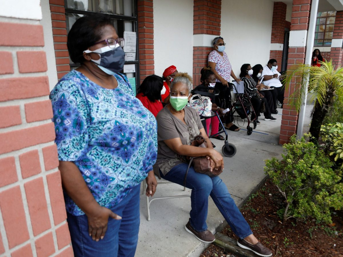 Members from historic African-American churches in the Tampa Bay Area prepare to receive the Pfizer-BioNTech COVID-19 vaccine