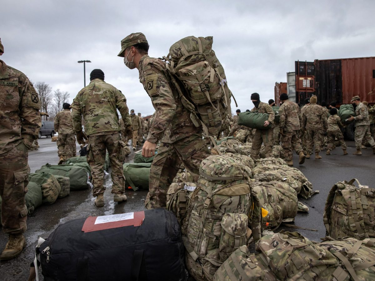 U.S. Army soldiers retrieve their duffel bags after they returned home from a 9-month deployment to Afghanistan
