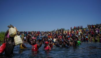 Haitian migrants cross the Rio Grande river to get food and water in Mexico
