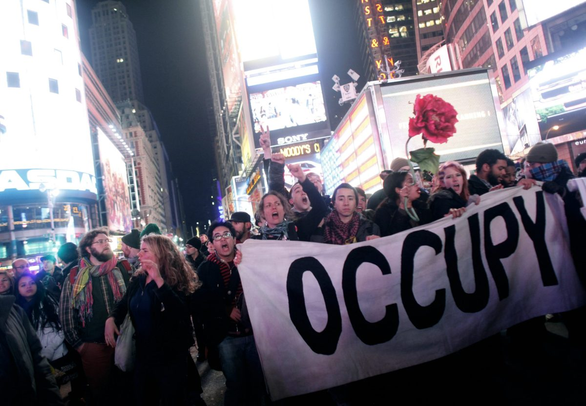 Occupy Wall Street activists demonstrate in Times Square in 2011