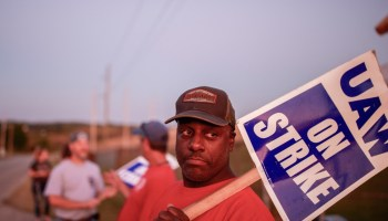 Workers from United Auto Workers Local 440 picket outside the General Motors Bedford Powertrain factory
