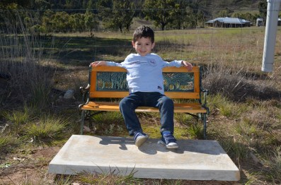 Levi chilling on a little bench