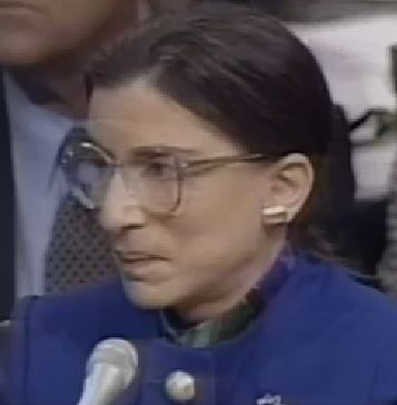 Justice Ginsburg's reaction when Sen. Feinstein recounts that the very same Harvard Law professor who asked her to justify her taking the place of a male now lists her with Justices Brennan and Marshall as the best justices in history