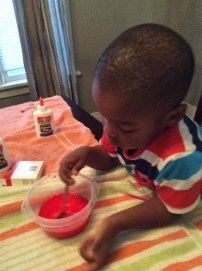 We add his favorite food color, and add a full bottle of elmers glue to the water bwl