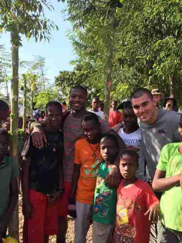 Tee Shepherd and Chad Kelly with new friends in Haiti