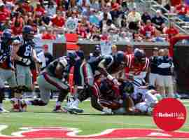 Kincade tackled by Red defense