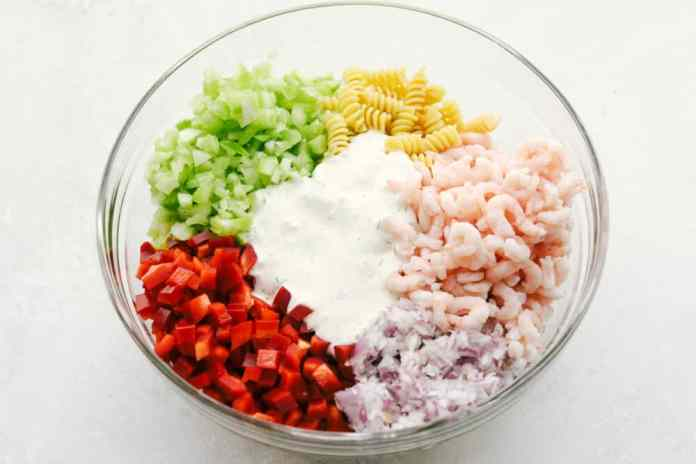 Shrimp pasta salad ingredients in bowl before mixing