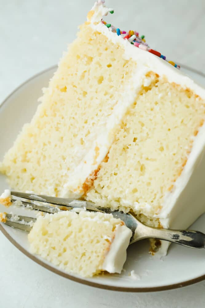 Taking a bite of The Absolute Best White Cake.