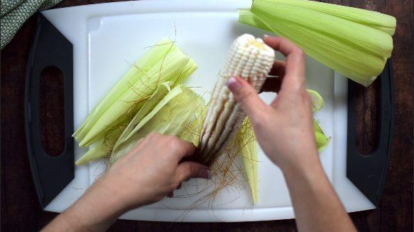 Remove silks from the corn.