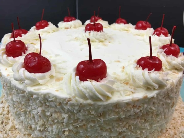 close up pineapple pina colada cake with Coconut cream frosting