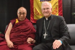 Archbishop Joseph E. Kurtz and His Holiness the Dalai Lama met briefly May 20, 2013, at the KFC Yum! Center. The Dalai Lama plans to visit Louisville again in 2017.