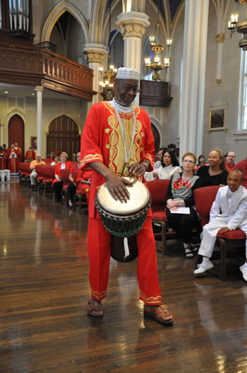 Brother Shahid Abdullah Shabazz led the procession with an African drum solo at the multicultural Pentecost celebration May 24.