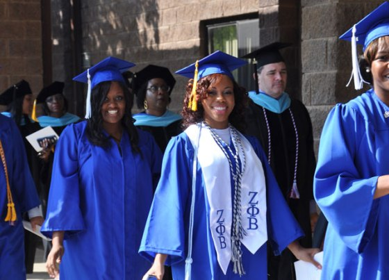 Spalding University awarded 586 undergraduate and graduate degrees at its commencement exercises June 6. Graduates, left, processed into Canaan Christian Church, 2840 Hikes Lane. Others took time to stop for a quick photo, below, before the ceremony began. (Record Photos by Jessica Able)
