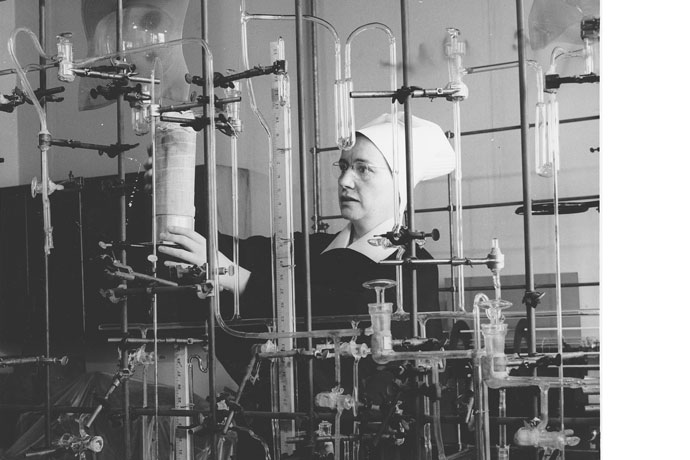 Sister of Charity of Nazareth Margaret Hohman is shown working in a laboratory in 1962 at St. Louis University, where she earned a doctoral degree in chemistry. Photo Special to The Record