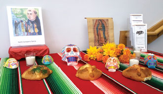 A Día de los Muertos altar has been erected in the entry of the Maloney Center, 1200 S. Shelby Street. The purpose of the altar — an ancient tradition dating to the Meso-American civilizations — is to remember those who have died. Five other altars are on display throughout the archdiocese. (Record Photo by Marnie McAllister)