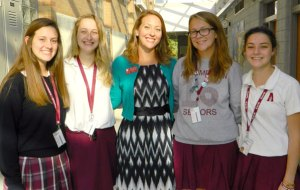 Abby Asfahl, center, guidance counselor and moderator of the Green Dot Club with the club's officers.  (Record photo by Ruby Thomas)
