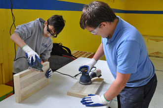 Seventh-graders Evan Burks, left, and Cody Montgomery sanded boards for a project.