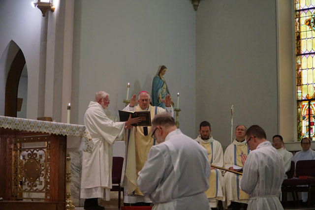 Archbishop Joseph E. Kurtz completes the prayer of ordination.
