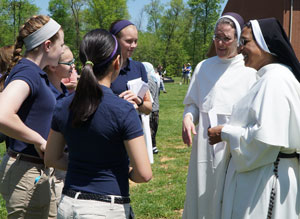 Dominican Sisters of St. Cecilia spoke with a group of students from St. James School prior to a ceremonial ground breaking for a convent on the school's campus April 24. (Record Photo by Ruby Thomas)