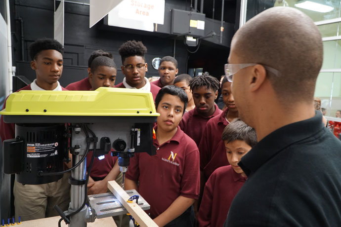 Eighth-grade students at Nativity Academy at St. Boniface listened to a demonstration by a student from the University of Louisville's J.B. Speed School of Engineering April 25. The Speed School installed a state-of-the-art Science, Technology, Engineering and Mathematics (STEM) center — called a maker space — at the independent Catholic school. (Record Photo by Jessica Able)