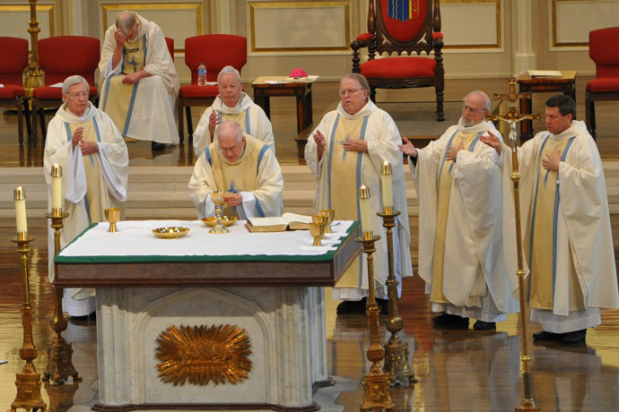 Ten priests were honored at the annual Presbyteral Jubilee Mass May 16 at the Cathedral of the Assumption. Pictured from left are: Fathers David Zettel, Eugene Scheich (seated), Timothy A. Hogan, Archbishop Joseph E. Kurtz, Father John D. Deatrick, Passionist Father Eric Meyer and Father J. Mark Spalding. (Record Photo by Jessica Able)