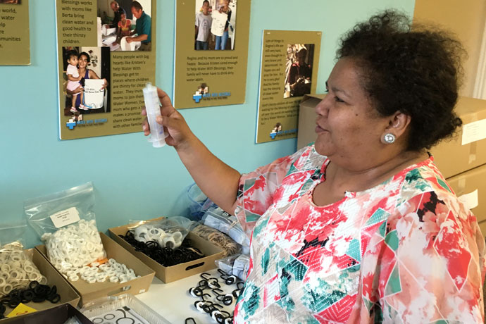 Volunteer Patricia Zajia, a native of Ecuador, put together water filtration kits at the Water With Blessings office in Middletown May 2. Close to 700 kits have been shipped to earthquake victims in Ecuador. (Photo Special to The Record)