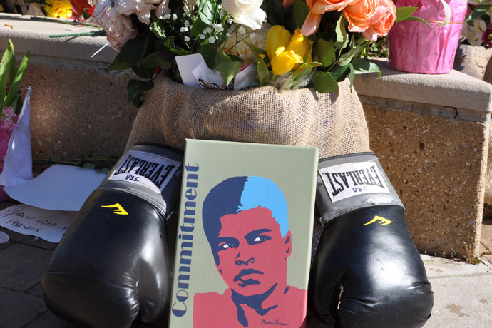 Memorials honoring the late Muhammad Ali stand in front of the Muhammad Ali Center, 144 N. Sixth Street, on June 7. (Record Photo by Jessica Able)