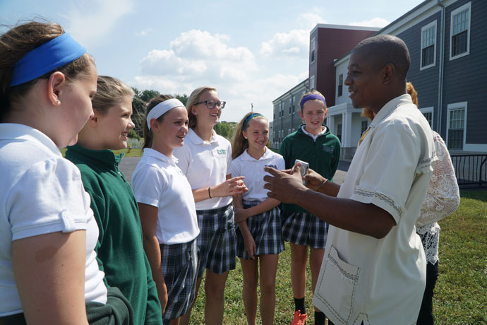 Parish welcomes priest from Haiti  Father Jean Bernadin Paul, pastor of St. Louis De Gonzague Church in Bon Bon, Haiti, visited students at St. Mary Academy Sept. 8. Father Bernadin Paul thanked students and teachers for their donation of 47 boxes of school supplies sent last April to his parish's schools. St. Bernadette Church in Prospect, Ky., and the Haiti parish have a twinning relationship. The relationship started in 1996 with Transfiguration Church, one of the parishes that merged to form St. Bernadette in 2008. The relationship was recently rekindled. (Record Photo by Ruby Thomas)