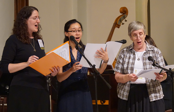 """A choir formed by """"Women of the Church"""" conference participants led music during the opening and closing liturgical events. (Record Photo by Marnie McAllister)"""
