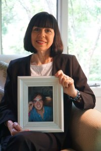Linda Squire, a member of the Cathedral of the Assumption, held a picture of her son Jonathan, who died in 2015 of an accidental overdose of fentanyl. (Record Photo by Marnie McAllister)