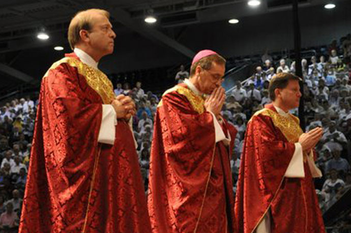 In this file photo, Archbishop-designate Charles C. Thompson, center, is flanked by Archdiocese of Louisville priests, Father Dale Cieslik, left, the bishop's first cousin, and Father J. Mark Spalding, archdiocesan vicar general, during his ordination as Bishop of Evansville, Ind., June 29, 2011. (File Photo by Jessica Able)