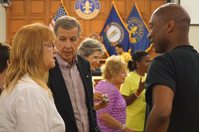 Ed Harpring, center, pro-life coordinator for the Archdiocese of Louisville, spoke to Peggy Strange and Parnell Minter following the Louisville Metro Council meeting July 19. (Record Photo by Ruby Thomas)