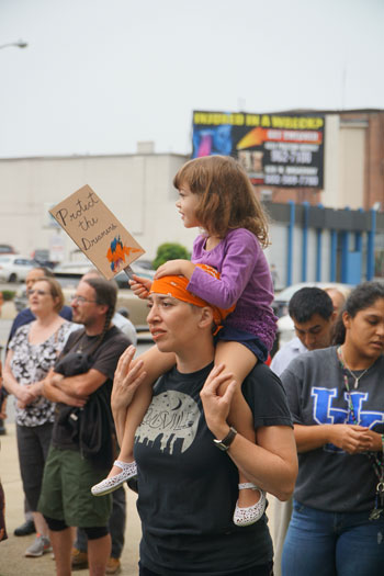 A woman and child display a sign 'Support the dreamers' at a rally to support the Deferred Action for Childhood Arrivals Sept. 5 in downtown Louisville.