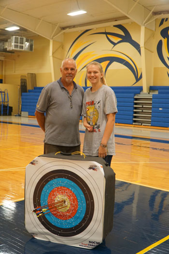 Faith Oakley, a junior at Bethlehem High School in Bardstown, Ky., is pictured with one David Carrico, one of her coaches at Bethlehem.