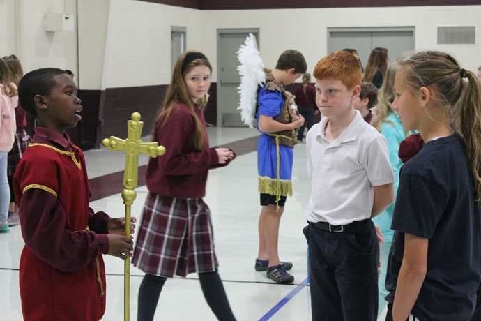 St. Athanasius School eighth-graders dressed as saints and told their schoolmates about their saints Nov. 2. Kisaiah Hess, left, dressed as John the Baptist. (Photo Special to The Record)