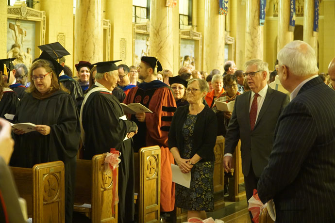 Dr. Susan M. Donovan and Dr. Bill Donovan walk in the procession at the Inaugural Mass at St. Agnes Church Oct. 27. Dr. Susan Donovan was formally inaugurated as the fourth president of Bellarmine in a ceremony at Knights Hall later in the day. (Record Photo by Jessica Able)