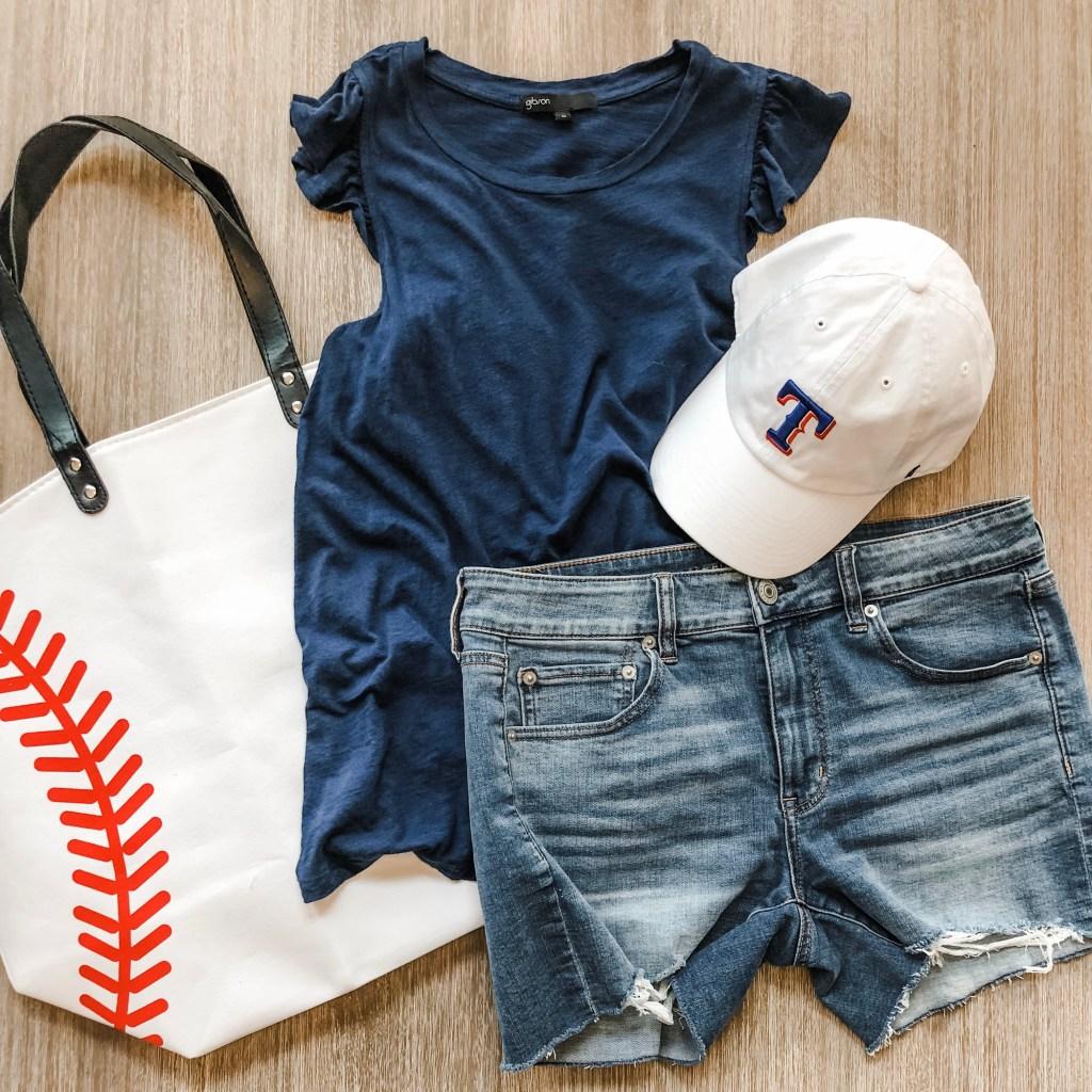 Perfect baseball mom attire- denim shorts, cute ruffle tank, hat and a big baseball tote bag.