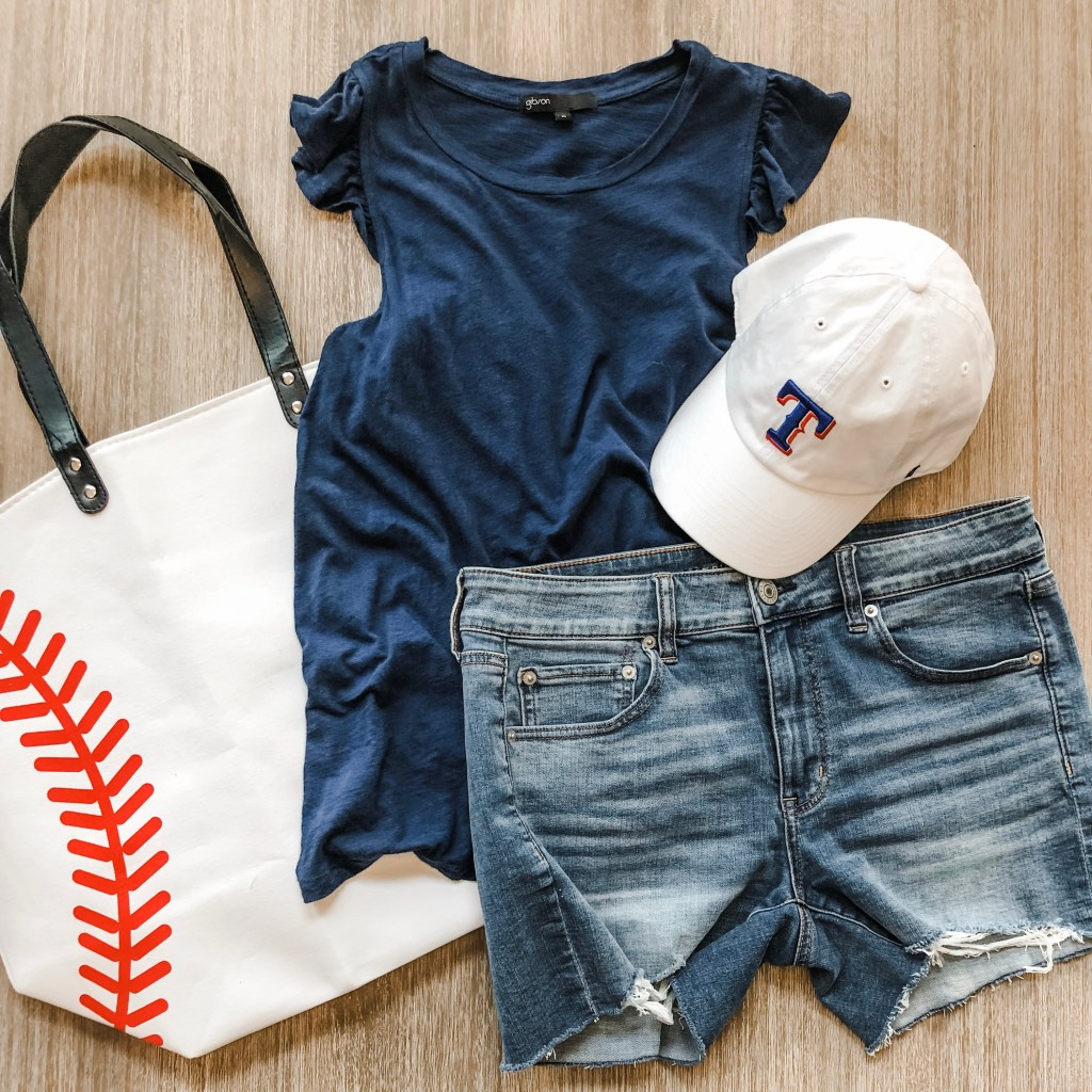 Perfect baseball mom attire- denim shorts, cute ruffle tank, hat and a big baseball tote bag.