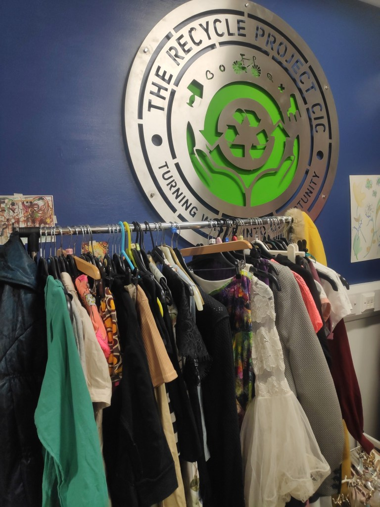 Clothes swap with recycle project logo