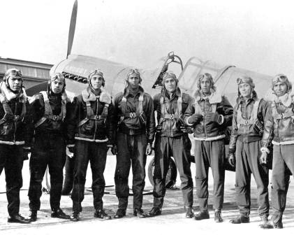 Tuskegee Airmen in 1943, with a P-40 in the background. Photo courtesy of the National U.S. Air Force Museum