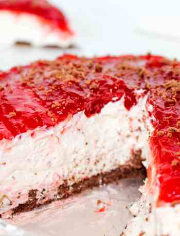 Gluten Free Black Bottom Cheesecake: A sinfully decadent dessert that is simple to make (no-bake!) and features layers of crisp chocolate, tangy cheesecake, and a sweet berry topping of your choosing.