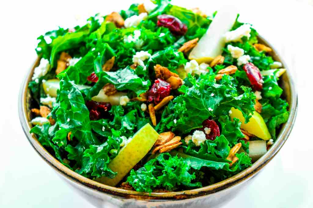 Kale and Cranberry salad is a deliciously festive dish with tart cranberries, crisp kale, and sweet pears. It is topped with fresh gorgonzola and cardamom spiced almonds then drizzled with a homemade cranberry vinaigrette. It is the perfect marriage of flavors and a great addition to any party or get together. Simple enough to make for lunch but also beautiful for a more formal meal.