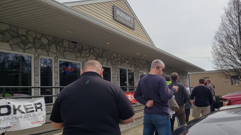 Customers wait in line outside of Hudson's Outfitters & Firearms in Pottstown, Pennsylvania on March 18, 2020